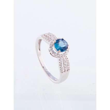 Anillo oro blanco de primera ley 18k con diamantes y topacio azul