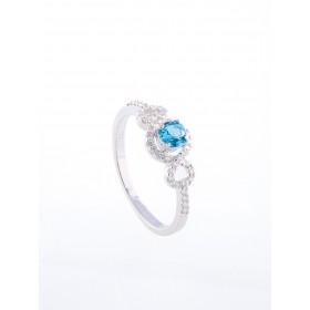 Anillo oro blanco de primera ley 18k con diamantes topacio azul